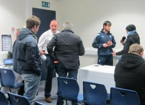 Paul Cook arrives as Lee finishes his interview