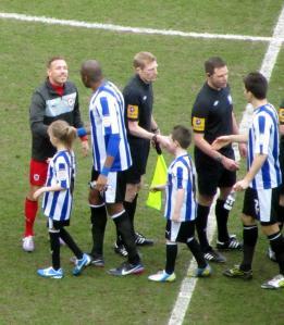 Craig Bellamy and Anthony Gardner shake hands
