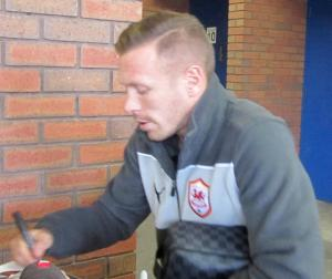 Craig Bellamy signs for the fans