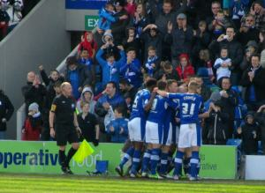 All the Chesterfield outfield players celebrate Jack's 93rd goal in a Chesterfield shirt