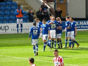 The players celebrate the fourth goal