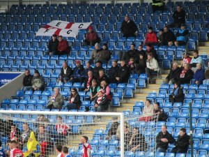 The away fans watch as their side is well beaten
