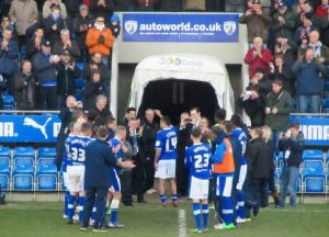 The players create a tunnel for Jack as he leaves the pitch