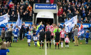 Jack Lester leads out the Spireites