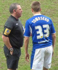 The referee has a chat to Conor Townsend