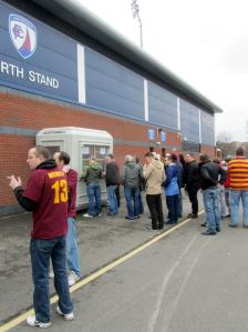 The away supporters queue for their tickets