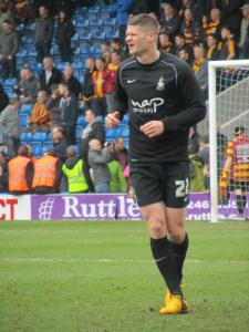 Bradford's Michael Nelson warms up