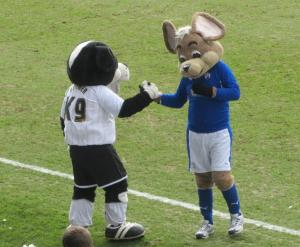 The two mascots shake hands