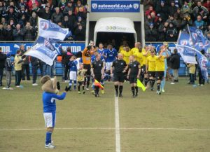 The two teams make their way onto the pitch
