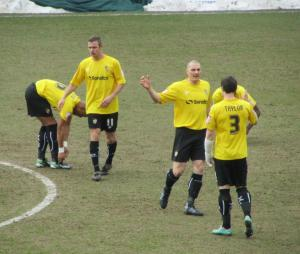 The Vale players prepare for kick off