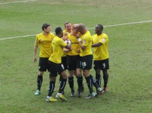 Darren Purse celebrates his early headed goal