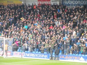 The travelling supporters celebrate