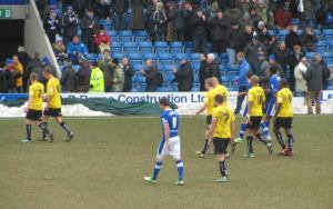 The players head to the dressing room at the interval