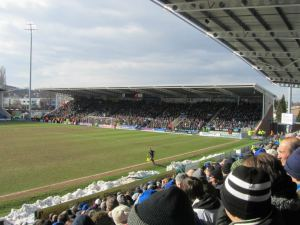 The supporters watch the game in the spring sunshine