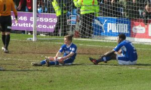 Townsend and Trotman desperatley defend for Chesterfield