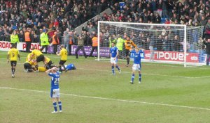Tom Pope heads home an equaliser