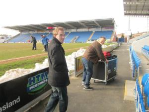 Taking the camera equipment away after the game