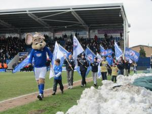 Chester and a few young Spireites carry flags around the pitch