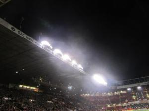 The lights shine over the stadium