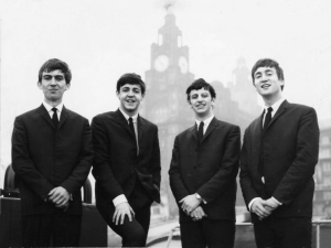 The Beatles pose for a shot outside the buildings