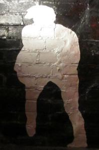 A silhouette of John, painted by Cynthia Lennon