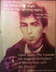 A picture of George Harrison in the entrance of the club