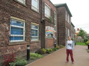 Stood outside the school that John Lennon and George Harrison both attended