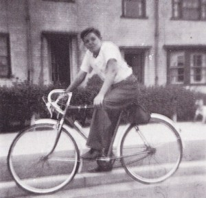 A young Paul McCartney on his bike outside his Ardwick Road home