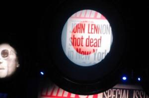 Various historic events are shown during the performance, including the assassination of John Lennon