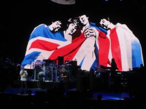 Another screen animation shows the four original members draped in the British flag