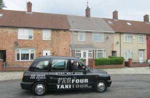 The taxi outside the house