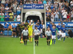 The teams make their way onto the pitch
