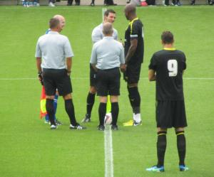 The two captains speak to the referee prior to kick off