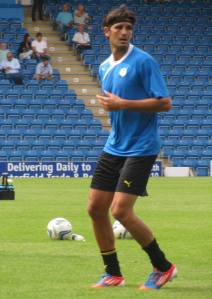 Miguel Llera warms up
