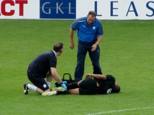 A Wednesday player receives treatment