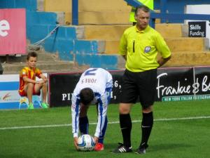 The referee makes sure Craig Jones take the free kick from the correct spot