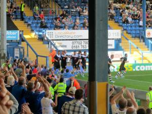 The players and fans celebrate the first goal of the new season