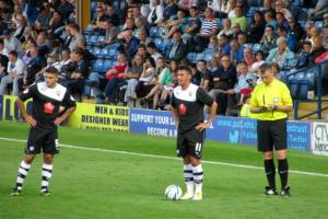 Roberts and Morsy stand over the ball