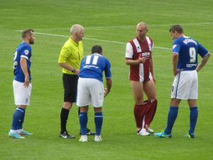 Gary Roberts cheekily pulls down an opposition players shorts!