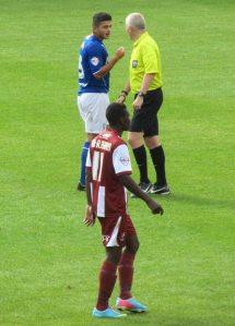 Sam Morsy speaks to the referee