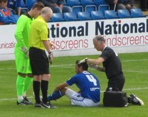 Physio Jamie Hewitt treats Sam Hird