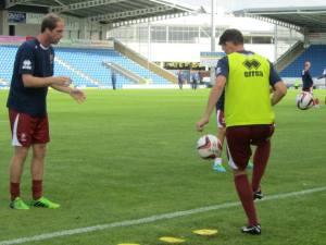 The Cheltenham players warm down