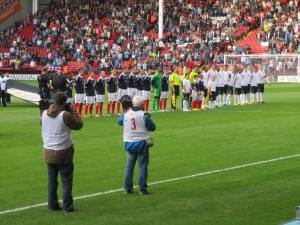 The teams line up on the pitch