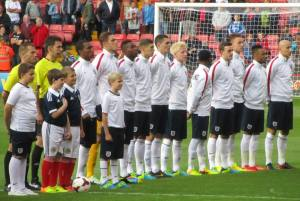 The England players stand for their national anthem