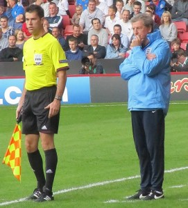 Hodgson stands on the touchline
