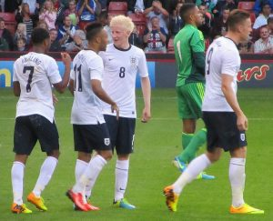 The England players congratulate Sterling