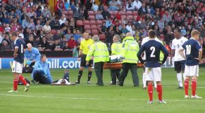 An England player has to be stretchered off in the first half
