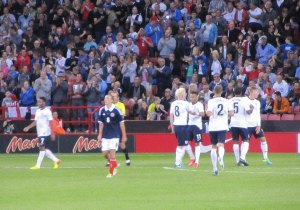The England players celebrate another goal
