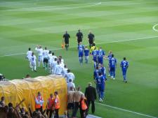 The teams make their way onto the field