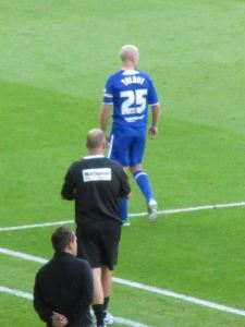 Paul Cook shouts orders to Chesterfield captain Drew Talbot